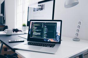 silver macbook laptop code editor